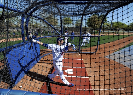 Los Angeles Dodgers Adrian Gonzalex hits during batting practice during the first full squad workout Thursday, February 25, 2016 at Camelback Ranch-Glendale in Phoenix, Arizona.