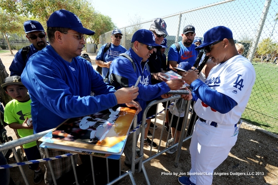 Los Angeles Dodgers Manager Dave Roberts signs for fans during the first full squad workout Thursday, February 25, 2016 at Camelback Ranch-Glendale in Phoenix, Arizona.