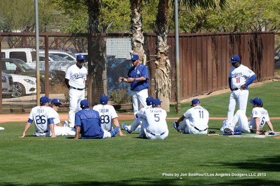 Los Angeles Dodgers base coaches George Lombard and Chris Woodward talk to the squad during the first full squad workout Thursday, February 25, 2016 at Camelback Ranch-Glendale in Phoenix, Arizona.