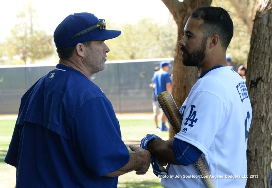 Los Angeles Dodgers hitting coach Turner Ward talks with Andre Ethier during the first full squad workout Thursday, February 25, 2016 at Camelback Ranch-Glendale in Phoenix, Arizona.