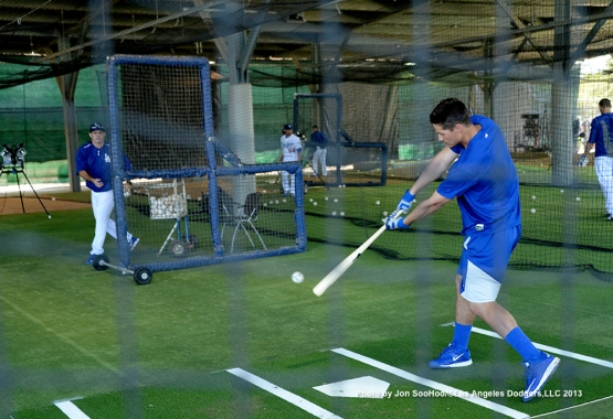 Los Angeles Dodgers Corey Seager hits in the cage with hitting coach Turner Ward during first full squad workout Thursday, February 25, 2016 at Camelback Ranch-Glendale in Phoenix, Arizona.