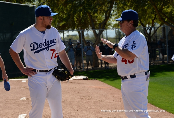 Los Angeles Dodgers pitching coach Rick Honeycutt works with RHP Chris Anderson during the  first full squad workout Thursday, February 25, 2016 at Camelback Ranch-Glendale in Phoenix, Arizona.
