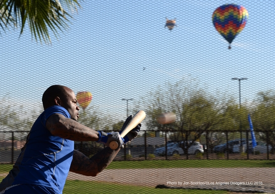 Los Angeles Dodgers Carl Crawford bunts with balloons during workout Friday, March 4, 2016 at Camelback Ranch-Glendale in Phoenix, Arizona.