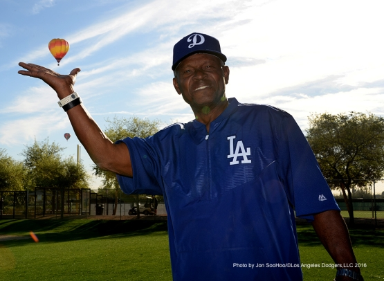 Los Angeles Dodgers Manny Mota holds a balloon during workout Friday, March 4, 2016 at Camelback Ranch-Glendale in Phoenix, Arizona.