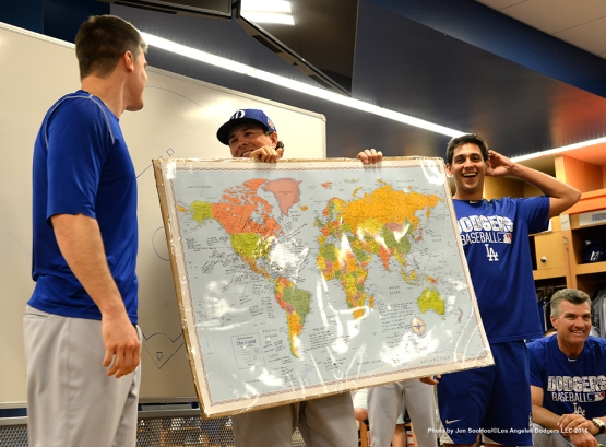 Los Angeles Dodgers Chris Stripling, Kyle Farmer and Jose De Leon show the team their map of teammate's origins prior to workout Tuesday, March 1, 2016 at Camelback Ranch-Glendale in Phoenix, Arizona.