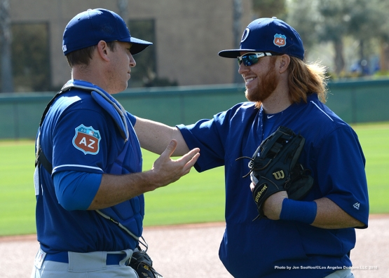 Los Angeles Dodgers A.J. Ellis and Justin Turner pose during workout Tuesday, March 1, 2016 at Camelback Ranch-Glendale in Phoenix, Arizona.