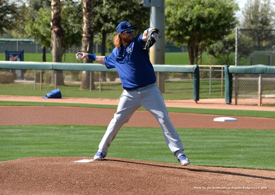 Los Angeles Dodgers Justin Turner pitches during workout Tuesday, March 1, 2016 at Camelback Ranch-Glendale in Phoenix, Arizona.