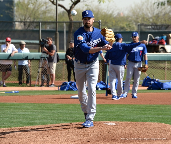 Los Angeles Dodgers Louis Coleman throws to first during workout Tuesday, March 1, 2016 at Camelback Ranch-Glendale in Phoenix, Arizona.