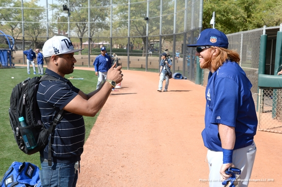 Los Angeles Dodgers Justin Turner talks with social media during workout Tuesday, March 1, 2016 at Camelback Ranch-Glendale in Phoenix, Arizona.