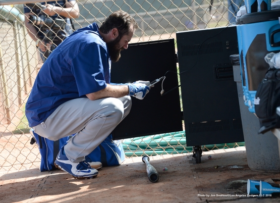 Los Angeles Dodgers Scott Van Slyke selects tunes during workout Tuesday, March 1, 2016 at Camelback Ranch-Glendale in Phoenix, Arizona.
