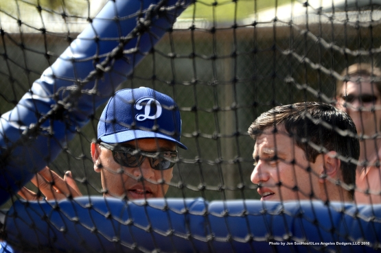 Los Angeles Dodgers Dave Roberts and Andrew Friedman talk during workout Tuesday, March 1, 2016 at Camelback Ranch-Glendale in Phoenix, Arizona.