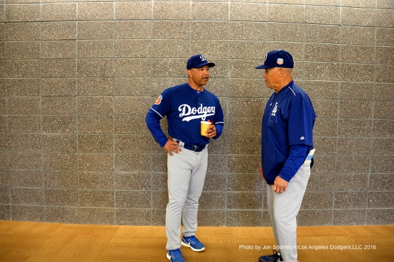 Los Angeles Dodgers Dave Roberts and Maury Wills talk before workout Wednesday, March 2, 2016 at Camelback Ranch-Glendale in Phoenix, Arizona.