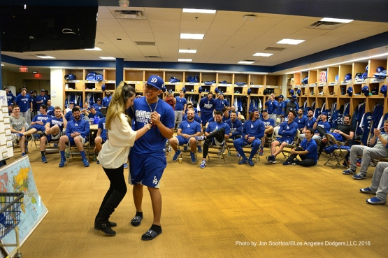 Los Angeles Dodgers Julio Urias shows off his dancing skills to the team prior to workout Wednesday, March 2, 2016 at Camelback Ranch-Glendale in Phoenix, Arizona.