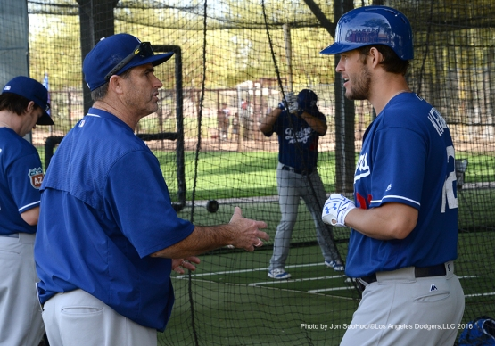 Los Angeles Dodgers Turner Ward and Clayton Kershaw talk  during workout Wednesday, March 2, 2016 at Camelback Ranch-Glendale in Phoenix, Arizona.