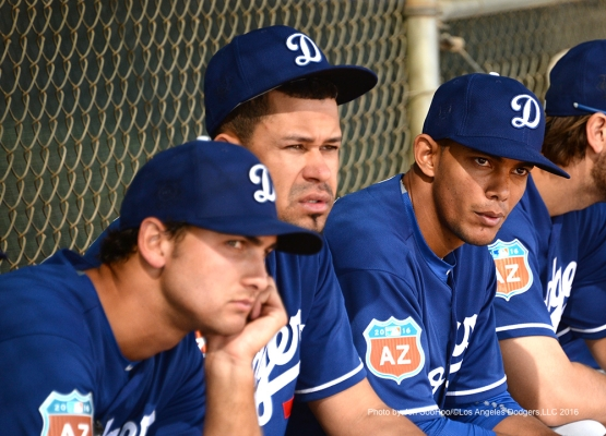 Los Angeles Dodgers Chase De Jong, Carlos Frias and Yasiel Sierra  sit during workout Wednesday, March 2, 2016 at Camelback Ranch-Glendale in Phoenix, Arizona.