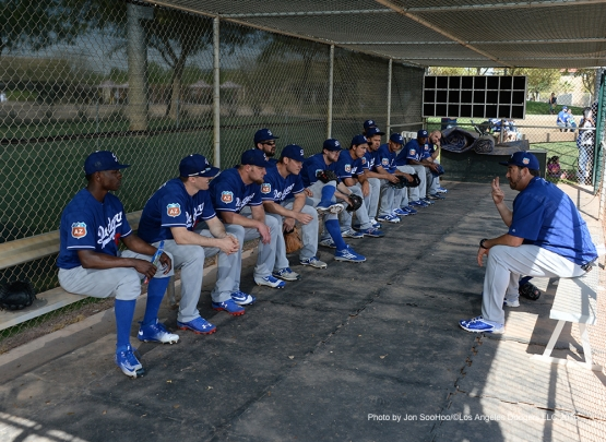 Los Angeles Dodgers coach Bill Simas talks to the pitchers during simulated game Wednesday, March 2, 2016 at Camelback Ranch-Glendale in Phoenix, Arizona.