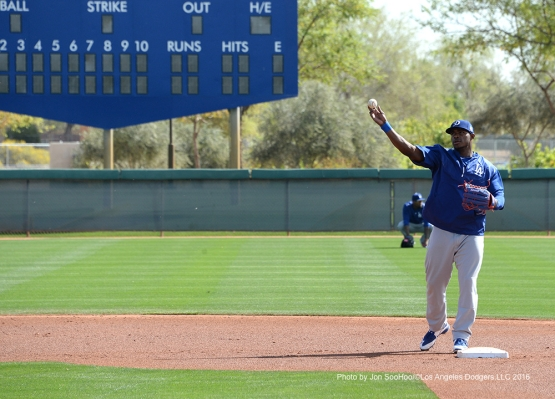 Los Angeles Dodgers Yasiel Puig throws from second base during workout Wednesday, March 2, 2016 at Camelback Ranch-Glendale in Phoenix, Arizona.