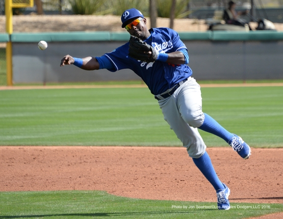 Los Angeles Dodgers Elian Herrera throws to first during workout Wednesday, March 2, 2016 at Camelback Ranch-Glendale in Phoenix, Arizona.