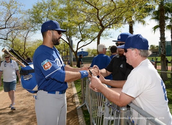 Los Angeles Dodgers Andre Ethier signs for fans after workout Wednesday, March 2, 2016 at Camelback Ranch-Glendale in Phoenix, Arizona.