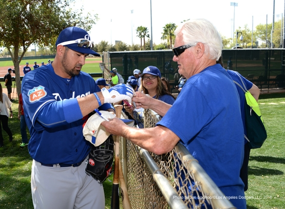 Los Angeles Dodgers Adrian Gonzalez signs for fans after workout Wednesday, March 2, 2016 at Camelback Ranch-Glendale in Phoenix, Arizona.