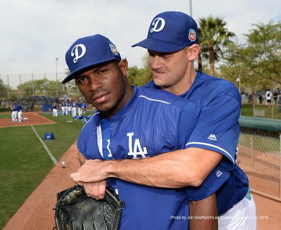 Los Angeles Dodgers Yasiel Puig and Jamey Wright during workout Thursday, March 3, 2016 at Camelback Ranch-Glendale in Phoenix, Arizona.