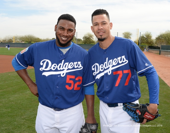 Los Angeles Dodgers Pedro Baez (sporting new haircut) and Carlos Frias pose during workout Thursday, March 3, 2016 at Camelback Ranch-Glendale in Phoenix, Arizona.