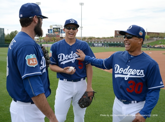 Los Angeles Dodgers Scott Van Slyke, Corey Seager and Dave Roberts during game against the Chicago White Sox Thursday, March 3, 2016 at Camelback Ranch-Glendale in Phoenix, Arizona.