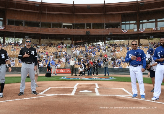 Los Angeles Dodgers manager Dave Roberts and Chicago White Sox manager Robin Ventura during the national anthem Thursday, March 3, 2016 at Camelback Ranch-Glendale in Phoenix, Arizona.