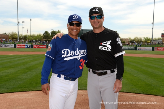 Los Angeles Dodgers manager Dave Roberts poses Chicago White Sox manager Robin Ventura Thursday, March 3, 2016 at Camelback Ranch-Glendale in Phoenix, Arizona.