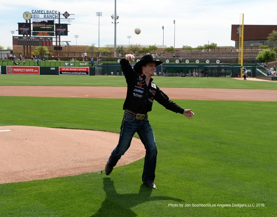 PBR Cooper Davis throws out the ceremonial first pitch before Los Angeles Dodgers game against the Chicago White Sox Thursday, March 3, 2016 at Camelback Ranch-Glendale in Phoenix, Arizona.