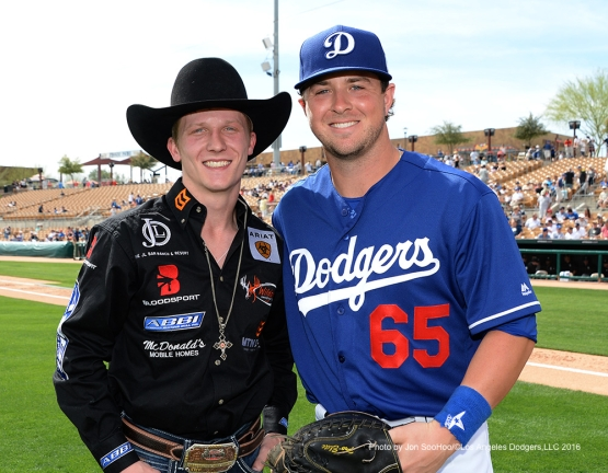 PBR Cooper Davis poses with Dodgers Kyle Farmer after ceremonial first pitch before game against the Chicago White Sox Thursday, March 3, 2016 at Camelback Ranch-Glendale in Phoenix, Arizona.