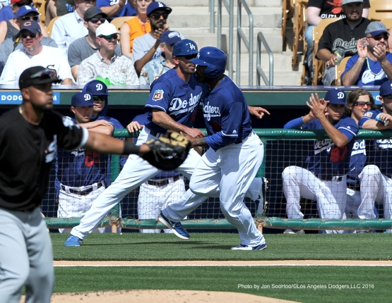 Los Angeles Dodgers Howie Kendrick scores during game against the Chicago White Sox Thursday, March 3, 2016 at Camelback Ranch-Glendale in Phoenix, Arizona.