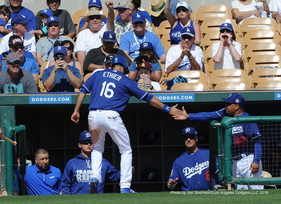 Los Angeles Dodgers Andre Ethier is greeted by manager Dave Roberts after scoring during game against the Chicago White Sox Thursday, March 3, 2016 at Camelback Ranch-Glendale in Phoenix, Arizona.