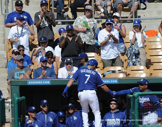 Los Angeles Dodgers Alex Guerrero is greeted by manager Dave Roberts after homer against the Chicago White Sox Thursday, March 3, 2016 at Camelback Ranch-Glendale in Phoenix, Arizona.