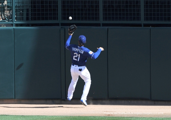 Los Angeles Dodgers Trayce Thompson runs down fly ball during game against the Chicago White Sox Thursday, March 3, 2016 at Camelback Ranch-Glendale in Phoenix, Arizona.