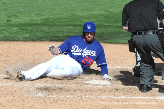 Los Angeles Dodgers Corey Brown slides home during game against the Chicago White Sox Thursday, March 3, 2016 at Camelback Ranch-Glendale in Phoenix, Arizona.