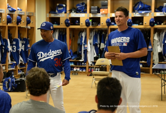 Los Angeles Dodgers Dave Roberts and Corey Seager talk to the team prior to workout Saturday, March 5, 2016 at Camelback Ranch-Glendale in Phoenix, Arizona.