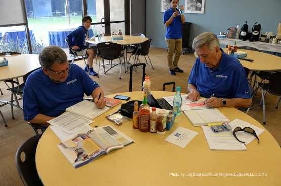 Los Angeles Dodgers Charley Steiner and Rick Monday prepare for the game with starting pitcher Kenta Maeda behind Saturday, March 5, 2016 at Camelback Ranch-Glendale in Phoenix, Arizona.