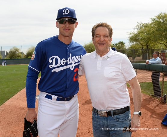 Los Angeles Dodgers Trayce Thompson and Peter Guber pose during  workout Saturday, March 5, 2016 at Camelback Ranch-Glendale in Phoenix, Arizona.