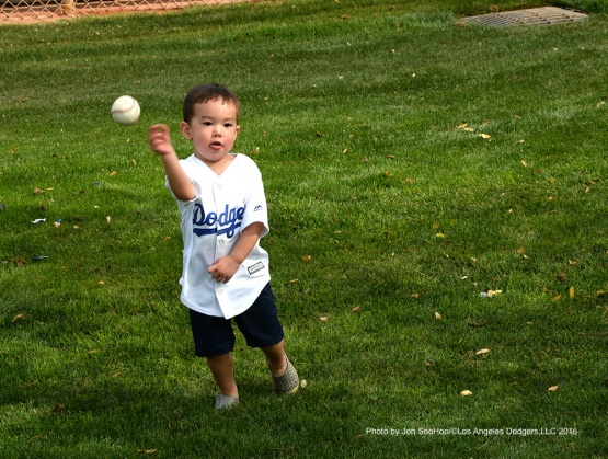 Young Los Angeles Dodger throws the ball during workout Saturday, March 5, 2016 at Camelback Ranch-Glendale in Phoenix, Arizona.