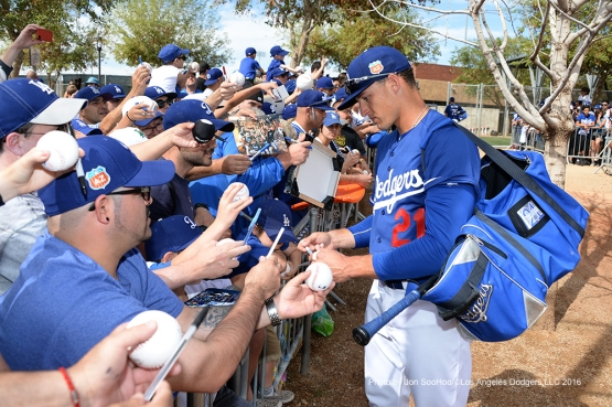 Los Angeles Dodgers Trayce Thompson signs for fans during workout Saturday, March 5, 2016 at Camelback Ranch-Glendale in Phoenix, Arizona.