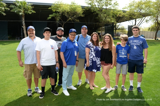 Los Angeles Dodgers Jaime Jarrin and guests pose during workout Saturday, March 5, 2016 at Camelback Ranch-Glendale in Phoenix, Arizona.