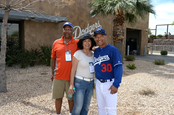 Los Angeles Dodgers Dave Roberts pose with mom Eiko and dad Waymon during workout Saturday, March 5, 2016 at Camelback Ranch-Glendale in Phoenix, Arizona.
