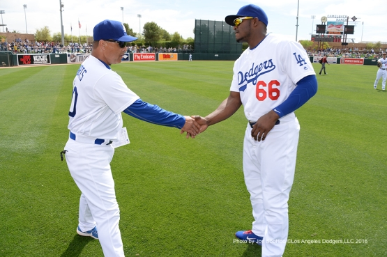 Los Angeles Dodgers Dave Roberts and Yasiel Puig prior to game against the Arizona Diamondbacks  Saturday, March 5, 2016 at Camelback Ranch-Glendale in Phoenix, Arizona.
