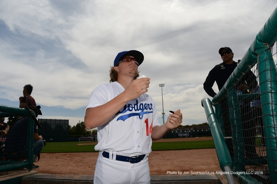Los Angeles Dodgers Kike Hernandez signs for fans prior to game against the Arizona Diamondbacks  Saturday, March 5, 2016 at Camelback Ranch-Glendale in Phoenix, Arizona.
