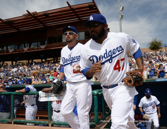 Los Angeles Dodgers Adrian Gonzalez and Howie Kendrick take the field to start the game against the Arizona Diamondbacks  Saturday, March 5, 2016 at Camelback Ranch-Glendale in Phoenix, Arizona.