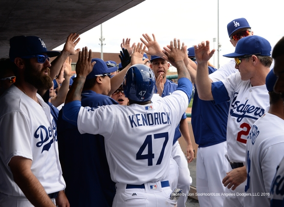 Los Angeles Dodgers Howie Kendrick high fives after scoring during game against the Arizona Diamondbacks  Saturday, March 5, 2016 at Camelback Ranch-Glendale in Phoenix, Arizona.