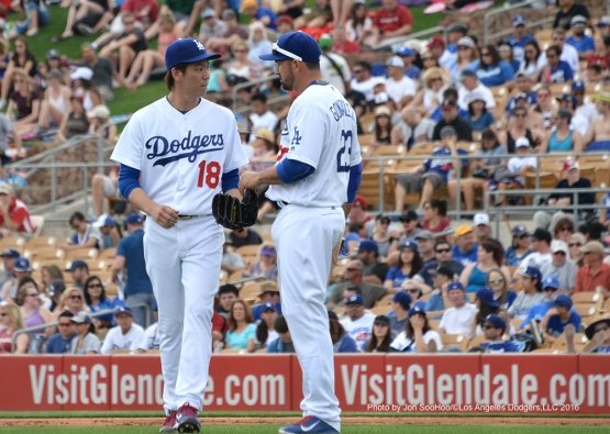 Los Angeles Dodgers Kenta Maeda and Adrian Gonzalez talk during game against the Arizona Diamondbacks  Saturday, March 5, 2016 at Camelback Ranch-Glendale in Phoenix, Arizona.