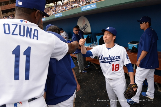 Los Angeles Dodgers Kenta Maeda is greeted after second inning against  the Arizona Diamondbacks  Saturday, March 5, 2016 at Camelback Ranch-Glendale in Phoenix, Arizona.