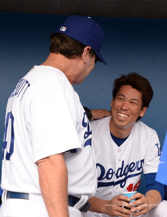 Los Angeles Dodgers Kenta Maeda and Rick Honeycutt are all smiles after two shut out inning against the Arizona Diamondbacks  Saturday, March 5, 2016 at Camelback Ranch-Glendale in Phoenix, Arizona.